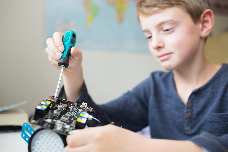 Boy repairing a robot